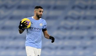 Manchester City's Riyad Mahrez holds the ball at the end of the English Premier League soccer match between Manchester City and Burnley at the Etihad stadium in Manchester, England, Saturday, Nov. 28, 2020. (Michael Regan/Pool via AP)