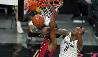 Baylor's Mark Vital (11) fouls Louisiana-Lafayette's Theo Akwuba during the first half of an NCAA college basketball game Saturday, Nov. 28, 2020, in Las Vegas. (AP Photo/John Locher)