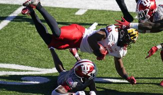 Maryland's Brian Cobbs (15) is tackled by Indiana's Tiawan Mullen (3) during the first half of an NCAA college football game, Saturday, Nov. 28, 2020, in Bloomington, Ind. (AP Photo/Darron Cummings)