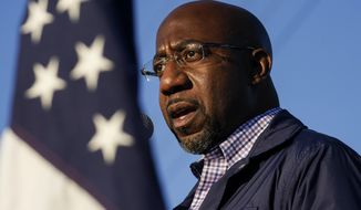 In this Nov. 15, 2020, file photo Raphael Warnock, a Democratic candidate for the U.S. Senate, speaks during a campaign rally in Marietta, Ga. Warnock and U.S. Sen. Kelly Loeffler are in a runoff election for the Senate seat. (AP Photo/Brynn Anderson, File)  **FILE**