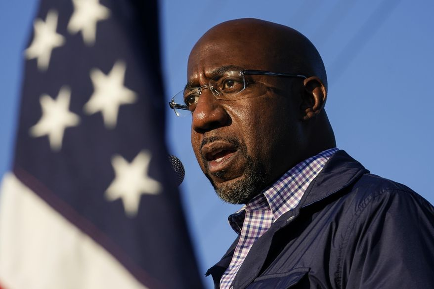 In this Nov. 15, 2020, file photo, Raphael Warnock, a Democratic candidate for the U.S. Senate, speaks during a campaign rally in Marietta, Ga. Warnock and U.S. Sen. Kelly Loeffler are in a runoff election for the Senate seat. (AP Photo/Brynn Anderson, File)  ** FILE **