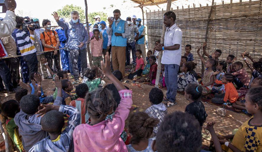 Filippo Grandi, U.N. High Commissioner for Refugees, visits Umm Rakouba refugee camp sheltering people who fled the conflict in Ethiopia's Tigray region in Qadarif, eastern Sudan, Saturday, Nov. 28, 2020. (AP Photo/Nariman El-Mofty)
