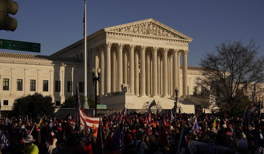 In this Nov. 14, 2020, file photo supporters of President Donald Trump attend pro-Trump marches outside the Supreme Court Building in Washington. (AP Photo/Jacquelyn Martin, File) ** FILE **