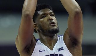 TCU's Kevin Samuel shoots during the second half of an NCAA college basketball game against Tulsa, Saturday, Nov. 28, 2020, in Kansas City, Mo. (AP Photo/Charlie Riedel)