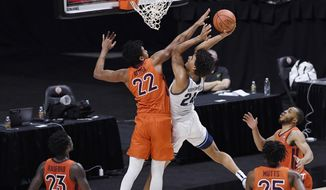 Villanova's Jeremiah Robinson-Earl, center right, goes up for a basket as Virginia Tech's Keve Aluma defends during the first half of an NCAA college basketball game, Saturday, Nov. 28, 2020, in Uncasville, Conn. (AP Photo/Jessica Hill)