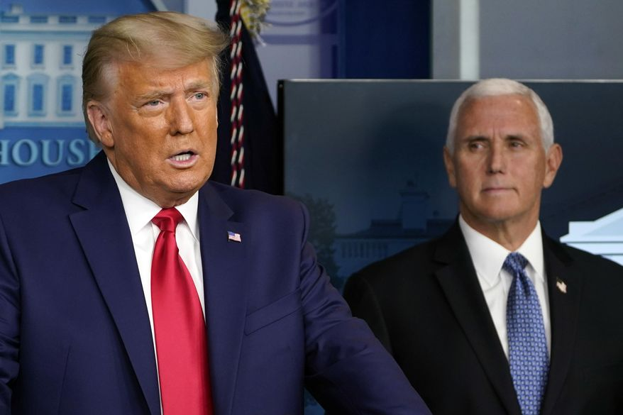 In this Nov. 24, 2020, file photo President Donald Trump speaks in the press briefing room as Vice President Mike Pence listens in Washington. (AP Photo/Susan Walsh, File)