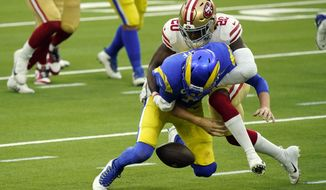 Los Angeles Rams quarterback Jared Goff, bottom, fumbles as he is hit by San Francisco 49ers free safety Jimmie Ward during the first half of an NFL football game Sunday, Nov. 29, 2020, in Inglewood, Calif. (AP Photo/Alex Gallardo)