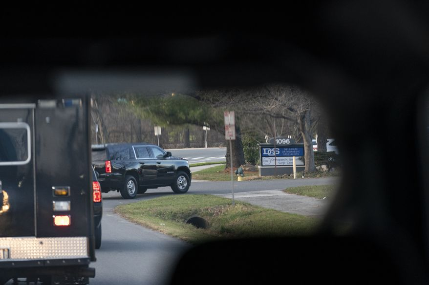A motorcade with President-elect Joe Biden aboard arrives at Delaware Orthopedic Specialists to see a doctor, Sunday, Nov. 29, 2020, in Newark, Del. Biden slipped while playing with his dog Major and twisted his ankle. (AP Photo/Carolyn Kaster)