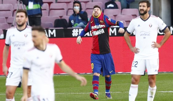 Barcelona's Lionel Messi celebrates after scoring his side's fourth goal during the Spanish La Liga soccer match between FC Barcelona and Osasuna at the Camp Nou stadium in Barcelona, Spain, Sunday, Nov. 29, 2020. (AP Photo/Joan Monfort)