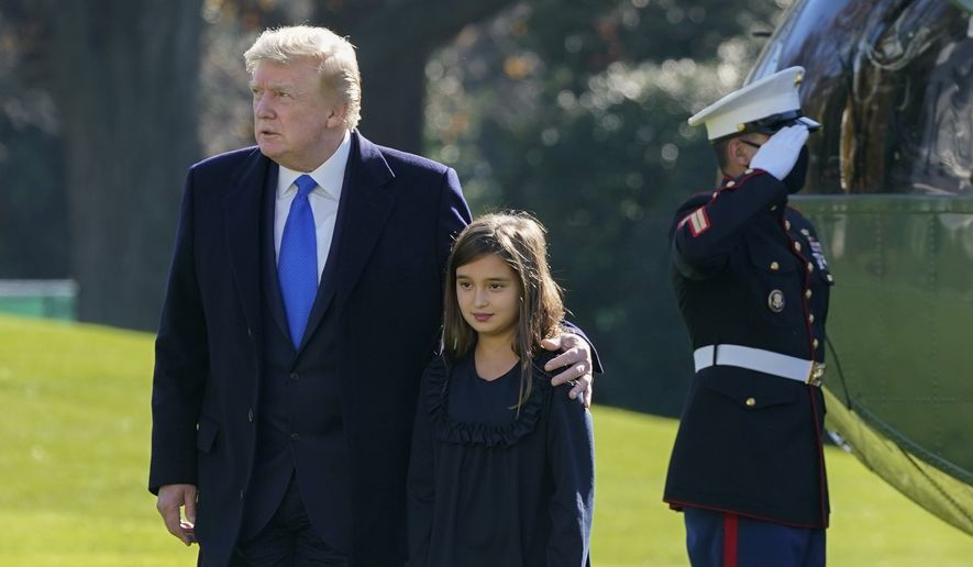 President Donald Trump walks with his granddaughter Arabella Kushner on the South Lawn of the White House in Washington, Sunday, Nov. 29, 2020, after stepping off Marine One. President Trump is returning from Camp David. (AP Photo/Patrick Semansky)