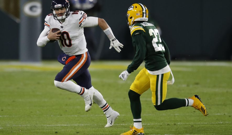 Chicago Bears' Mitchell Trubisky tries to get past Green Bay Packers' Jaire Alexander during the first half of an NFL football game Sunday, Nov. 29, 2020, in Green Bay, Wis. (AP Photo/Matt Ludtke)