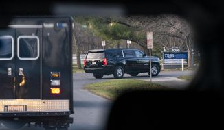 A motorcade with President-elect Joe Biden aboard arrives at Delaware Orthopaedic Specialists to see a doctor, Sunday, Nov. 29, 2020, in Newark, Del. Biden slipped while playing with his dog Major, and twisted his ankle. (AP Photo/Carolyn Kaster)