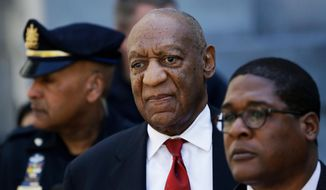 FILE - In this April 26, 2018 file photo, Bill Cosby, center, leaves the the Montgomery County Courthouse in Norristown, Pa., after being convicted of drugging and molesting a woman. The actor has spent more than two years in prison since he was convicted of sexual assault in the first celebrity trial of the #MeToo era. Now the Pennsylvania Supreme Court is set to hear his appeal of the conviction on Tuesday, Dec. 1, 2020. The arguments will focus on the trial judge's decision to let five other accusers testify for the prosecution.  (AP Photo/Matt Slocum, File)