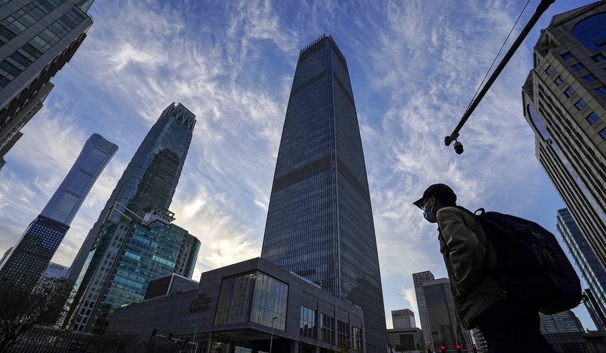 The Central Business District in Beijing gives the appearance of a global economic powerhouse, but China is exploiting its long-held classification as a 'developing' nation to benefit from international treaties, negotiations and commitments. (Associated Press photograph)