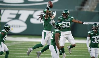 New York Jets' Harvey Langi, top, center, celebrates his fumble recovery during the second half of an NFL football game against the Miami Dolphins, Sunday, Nov. 29, 2020, in East Rutherford, N.J. (AP Photo/Corey Sipkin)