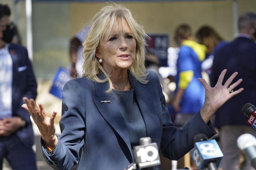 Jill Biden gestures as she speaks to reporters while campaigning for her husband Democratic presidential candidate and former Vice President Joe Biden, during a voting poll meet and greet Tuesday, Nov. 3, 2020, in St. Petersburg, Fla. (AP Photo/Chris O'Meara)