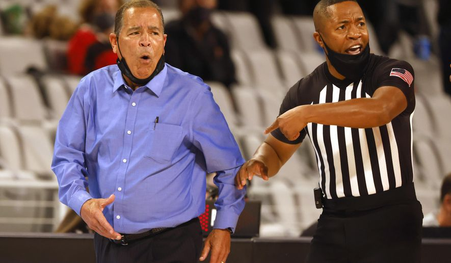 Houston head coach Kelvin Sampson, left, reacts after speaking with an official during the second half of an NCAA college basketball game against Texas Tech, Sunday, Nov. 29, 2020, in Fort Worth, Texas. (AP Photo/Ron Jenkins)