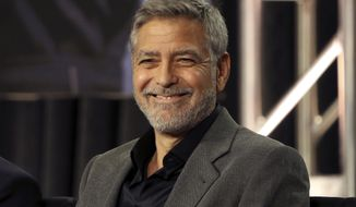 """In this Feb. 11, 2019, file photo, George Clooney participates in the """"Catch-22"""" panel during the Hulu presentation at the Television Critics Association Winter Press Tour at The Langham Huntington in Pasadena, Calif. In a Sunday, Nov. 29, 2020, interview on """"CBS Sunday Morning,"""" Clooney said he's been cutting his own hair for more than two decades with a Flowbee device. (Photo by Willy Sanjuan/Invision/AP, File)"""