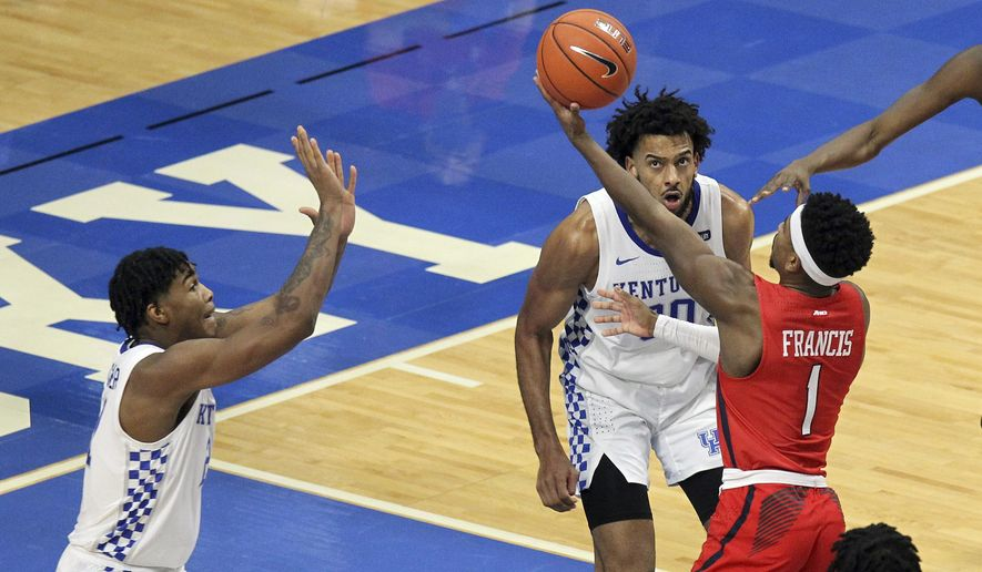 Richmond's Blake Francis (1) shoots near Kentucky's Cam'Ron Fletcher, left, and Olivier Sarr during the second half of an NCAA college basketball game in Lexington, Ky., Sunday, Nov. 29, 2020. (AP Photo/James Crisp)  **FILE**