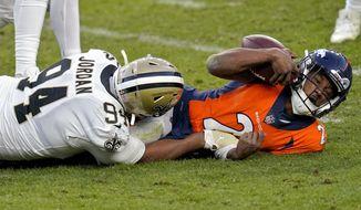 New Orleans Saints defensive end Cameron Jordan (94) sacks Denver Broncos quarterback Kendall Hinton (2) during the second half of an NFL football game, Sunday, Nov. 29, 2020, in Denver. (AP Photo/David Zalubowski) **FILE**