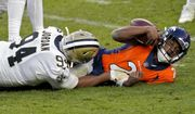 New Orleans Saints defensive end Cameron Jordan (94) sacks Denver Broncos quarterback Kendall Hinton (2) during the second half of an NFL football game, Sunday, Nov. 29, 2020, in Denver. (AP Photo/David Zalubowski) **FILE**