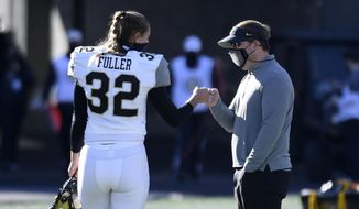 Vanderbilt place kicker Sarah Fuller (32) gets a fist-bump from Missouri head coach Eliah Drinkwitz after warming up before an NCAA college football game Saturday, Nov. 28, 2020, in Columbia, Mo. (AP Photo/L.G. Patterson) **FILE**