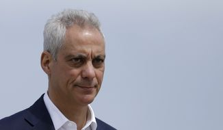 In this April 22, 2019, file photo, Chicago Mayor Rahm Emanuel waves as he arrives at a news conference outside of the south air traffic control tower at O'Hare International Airport in Chicago. (AP Photo/Kiichiro Sato, File)