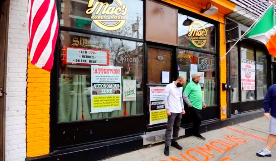 """Mac's Public House in Staten Island, New York, has declared itself an """"autonomous zone"""" after owners say their liquor license was revoked for refusing to close their doors due to coronavirus restrictions. (Screengrab via YouTube/@MattoosEntertainment)"""
