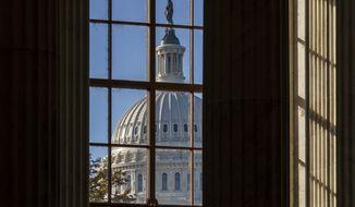 In this Nov. 10, 2020, file photo the morning sun illuminates the rotunda of the Russell Senate Office Building on Capitol Hill in Washington. (AP Photo/J. Scott Applewhite, File)  **FILE**
