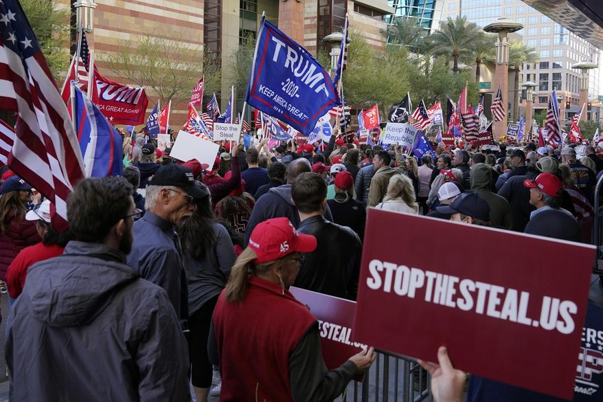 "Supporters of President Donald Trump protest in front of a local hotel where Arizona Republicans have scheduled a meeting as a ""fact-finding hearing"" to discuss the election, featuring members of Trump's legal team and Arizona legislators, Monday, Nov. 30, 2020, in Phoenix. (AP Photo/Ross D. Franklin) **FILE**"