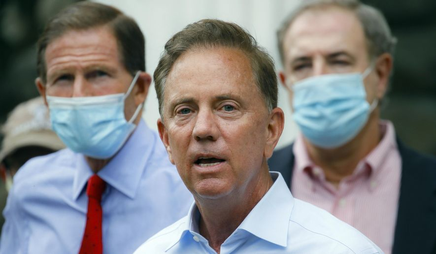 FILE- In this Aug. 7, 2020, file photo, Connecticut Gov. Ned Lamont addresses the media in Westport, Conn. On Wednesday, Nov. 25, 2020, Lamont imposed a steep new $10,000 fine on businesses that break the state's coronavirus rules. He said that the heftier fine is needed because some businesses have flagrantly violated the rules, and there are concerns for worker and customer safety during the holiday shopping season. (AP Photo/John Minchillo, File)