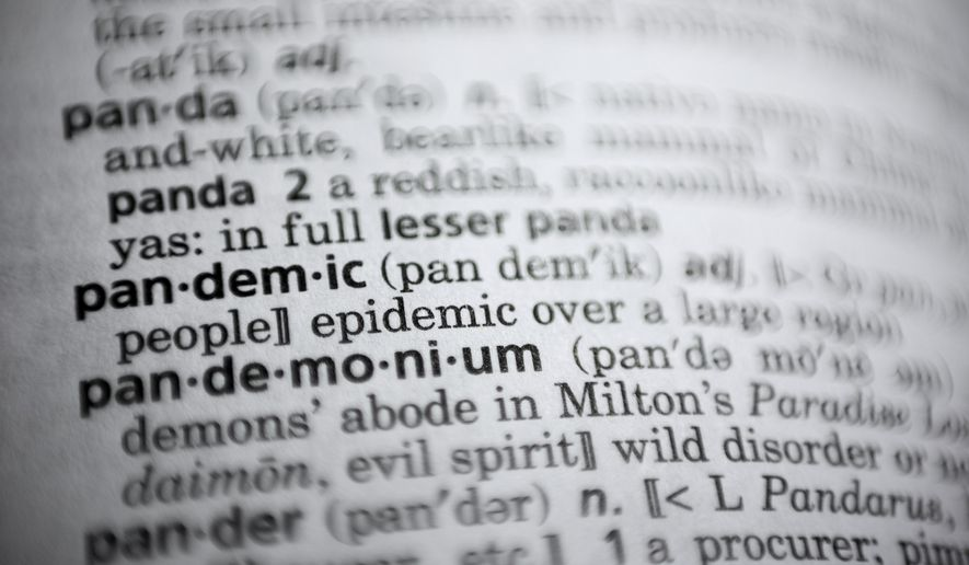 """In this Saturday, Nov. 21, 2020, photo the word pandemic is displayed in a dictionary in Washington. Merriam-Webster on Monday announced """"pandemic"""" as its 2020 word of the year. (AP Photo/Jenny Kane)"""