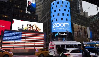 File-This April 18, 2019, file photo shows a Zoom ad, in New York. Zoom's videoconferencing service remains a fixture in pandemic life, but its breakneck growth is showing signs of tapering off as investors debate whether the company will be able to build upon its recent success after a vaccine enables people to intermingle again. Zoom highlighted its head-spinning success story again Monday, Nov. 30, 2020, with the release of its quarterly results for the August to October period. (AP Photo/Mark Lennihan, File)