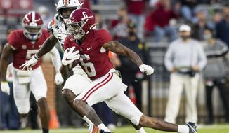Alabama wide receiver DeVonta Smith (6) breaks free for a touchdown against Auburn during an NCAA college football game Saturday, Nov. 28, 2020, in Tuscaloosa, Ala. (Mickey Welsh/The Montgomery Advertiser via AP)  **FILE**