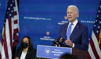 President-elect Joe Biden speaks as Vice President-elect Kamala Harris listens at left, during an event to introduce their nominees and appointees to economic policy posts at The Queen theater, Tuesday, Dec. 1, 2020, in Wilmington, Del. (AP Photo/Andrew Harnik)  **FILE**