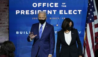 Presumptive President-elect Joe Biden and presumptive Vice President-elect Kamala Harris arrive at an event to introduce their nominees and appointees to economic policy posts at The Queen theater, Tuesday, Dec. 1, 2020, in Wilmington, Del. (AP Photo/Andrew Harnik)  **FILE**