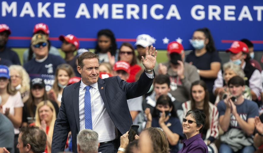 U.S. Rep. Ted Budd waves to the crowd during a campaign event at the Piedmont Triad International Airport in Greensboro, N.C., Tuesday, Oct. 27, 2020. (Khadejeh Nikouyeh/News & Record via AP) ** FILE **