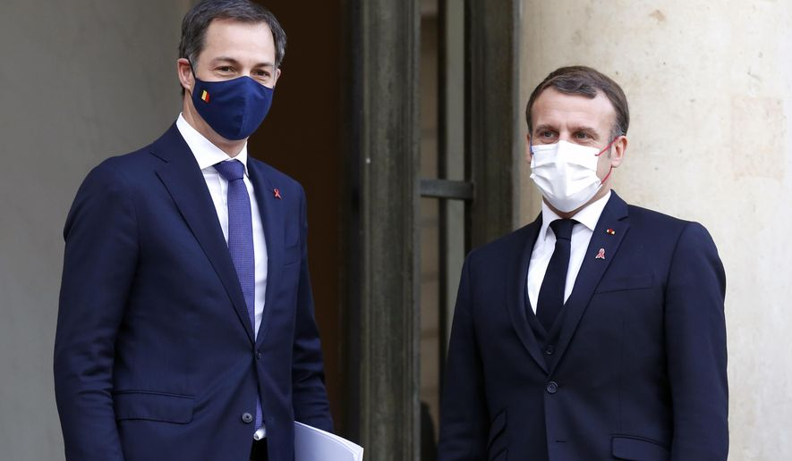 French President Emmanuel Macron, right, welcomes Belgium's Prime Minister Alexander De Croo, prior to a meeting, at the Elysee Palace, in Paris, France, Tuesday, Dec. 1, 2020. (AP Photo/Thibault Camus)