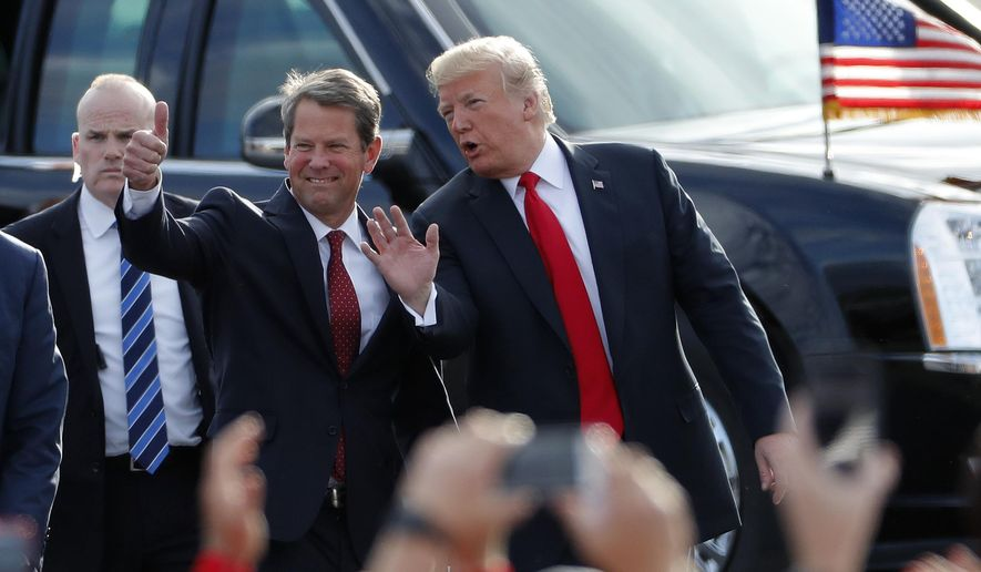In this Nov. 4, 2018, file photo, then-Georgia Republican gubernatorial candidate Brian Kemp, left, walks with President Donald Trump as Trump arrives for a rally in Macon , Ga. Ahead of his Dec. 5, 2020 rally, Mr. Trump is urging the Mr. Kemp to order a signature verification for mailed-in ballots. The state has already certified a Biden victory. (AP Photo/John Bazemore, File)  **FILE**