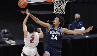 Villanova's Jeremiah Robinson-Earl (24) blocks a shot by Hartford's D.J. Mitchell (2) in the first half of an NCAA college basketball game, Tuesday, Dec. 1, 2020, in Uncasville, Conn. (AP Photo/Jessica Hill)