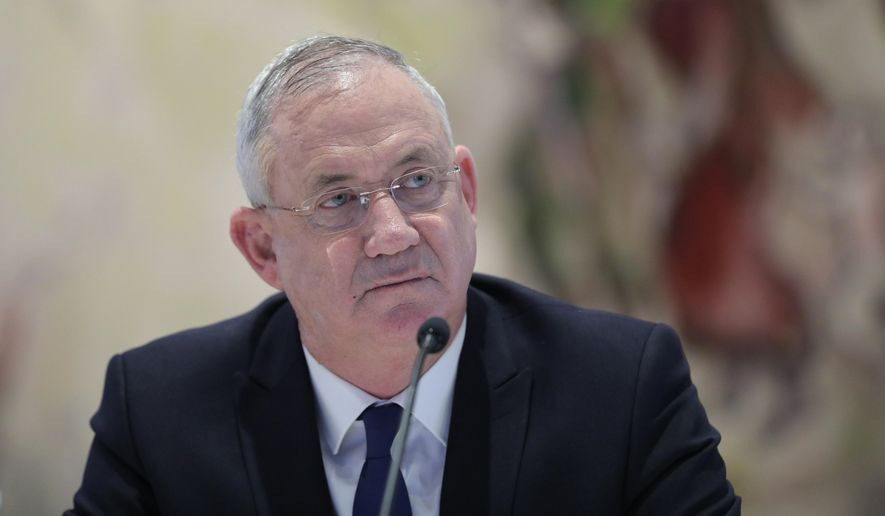 In this May 24, 2020 file photo, Israeli Defense Minister Benny Gantz attends the first Cabinet meeting of the new government at the Chagall Hall in the Knesset, the Israeli Parliament in Jerusalem, Israel. (Abir Sultan/Pool Photo via AP, File)  **FILE**