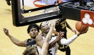 Purdue guard Brandon Newman (5) goes up for a layup during the first half of an NCAA college basketball game against Oakland Tuesday, Dec. 1, 2020 in West Lafayette, Ind. (Nikos Frazier/Journal & Courier via AP)