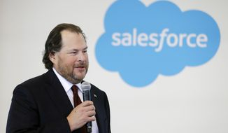 FILE - In this May 16, 2019, file photo, Salesforce chairman Marc Benioff speaks during a news conference, in Indianapolis. In a deal announced Tuesday, Dec. 1, 2020, business software pioneer Salesforce.com is buying work-chatting service Slack for $27.7 billion in a deal aimed at giving the two companies a better shot at competing against longtime industry powerhouse Microsoft. (AP Photo/Darron Cummings, File)