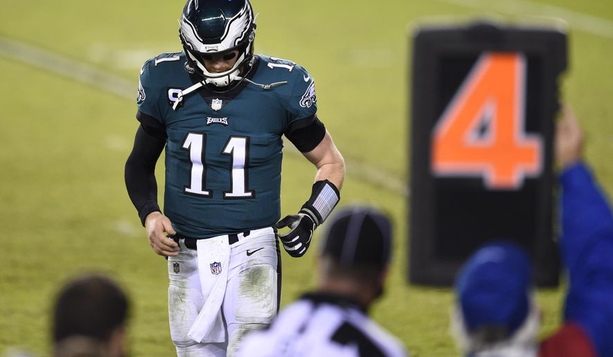 Philadelphia Eagles' Carson Wentz walks off the field during the second half of an NFL football game against the Seattle Seahawks, Monday, Nov. 30, 2020, in Philadelphia. (AP Photo/Derik Hamilton)