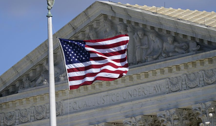 An American flag waves in front of the Supreme Court building, Monday, Nov. 2, 2020, on Capitol Hill in Washington. (AP Photo/Patrick Semansky)