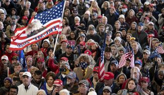 """Supporters listen to speakers during the """"Stop the Steal"""" rally with attorneys Lin Wood and Sidney Powell in Alpharetta, Ga., on Wednesday, Dec. 2, 2020. (Ben Gray/Atlanta Journal-Constitution via AP)"""