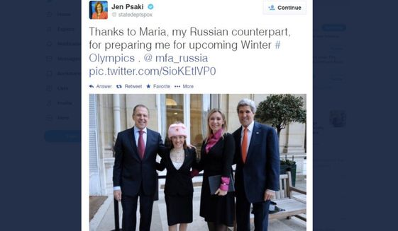 """Jen Psaki wears a communist hat with Russia's hammer and sickle design during her stint as State Department spokeswoman in 2014. Ms. Psaki, now the top pick to be presumptive president-elect Joseph R. Biden's White House press secretary, says anyone who shares the image while offering criticism """"is (unwitting or not) simply a puppet of the [Russian] propaganda machine."""""""