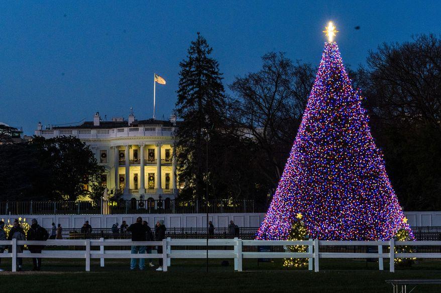 The National Christmas Tree is lit on the Ellipse near the White House, Wednesday, Dec. 2, 2020, in Washington. (AP Photo/Manuel Balce Ceneta)