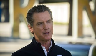 California Gov. Gavin Newsom speaks at a news conference at Cal Expo in Sacramento, California, Sept. 23, 2020. Several California politicians have been called out in the last month for their dining choices that violate the state's rules aimed at slowing the spread of coronavirus. Gov. Gavin Newsom, San Francisco Mayor London Breed and Los Angeles County supervisor all dined outdoors, conflicting with their own messaging to stay home. (Daniel Kim/The Sacramento Bee via AP, Pool) **FILE**