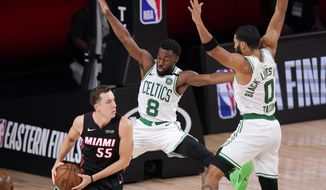 Miami Heat's Duncan Robinson (55) looks for help as Boston Celtics' Kemba Walker (8) and teammate Jayson Tatum (0) defend during the second half of an NBA conference final playoff basketball game Sunday, Sept. 27, 2020, in Lake Buena Vista, Fla. (AP Photo/Mark J. Terrill)